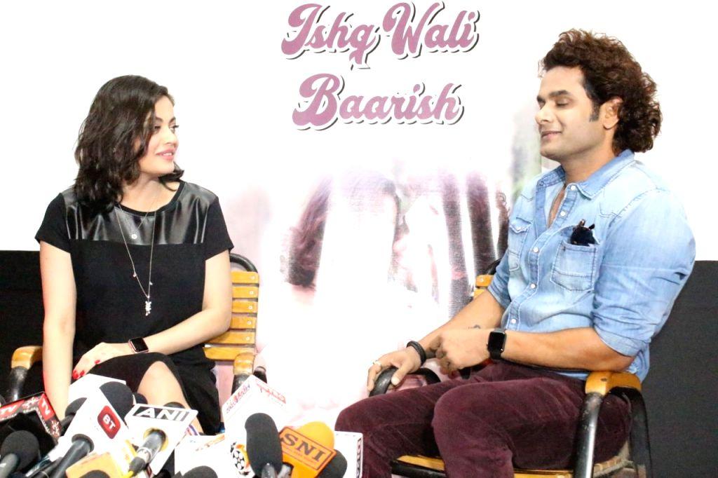 "Actors Qaiz Khan and Sneha Ullal during a press conference regarding song ""Ishq Wali Baarish"" in Mumbai. - Qaiz Khan and Sneha Ullal"