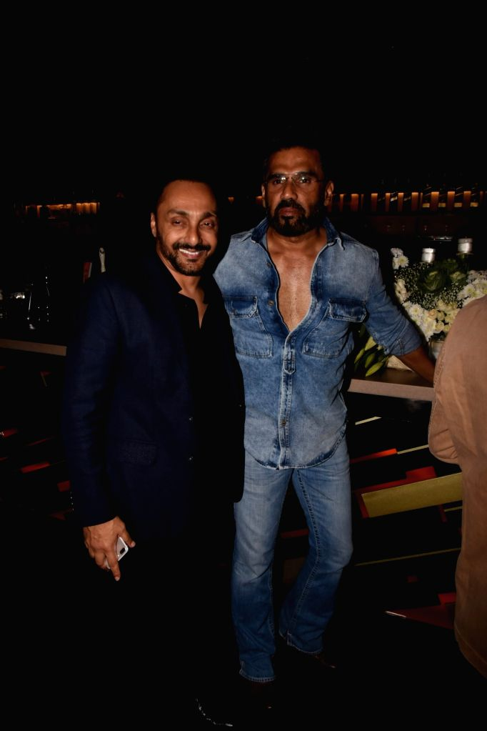 Actors Rahul Bose and Suneil Shetty at producer Tanuj Garg's birthday party in Mumbai on Dec 5, 2017. - Rahul Bose and Suneil Shetty