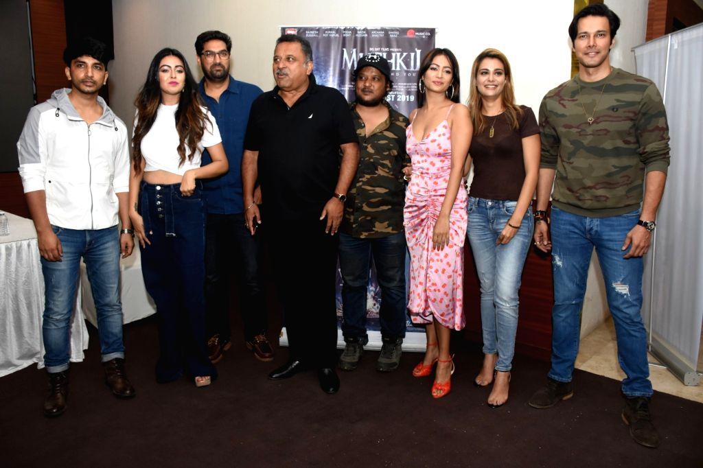 "Actors Rajneesh Duggal, Kunaal Roy Kapur, Pooja Bisht and filmmaker Ravindra Jeet Dariya at the song launch of their upcoming film ""Mushkil: Fear Behind You"" in Mumbai on July 18, ... - Rajneesh Duggal, Kunaal Roy Kapur and Pooja Bisht"