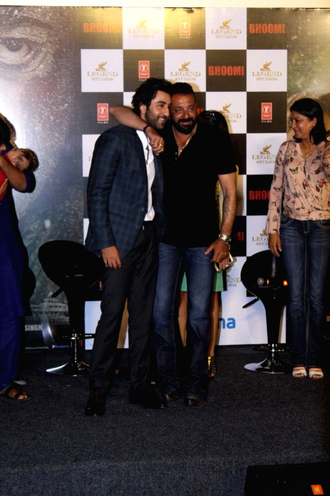 """Actors Ranbir kapoor and  Sanjay Dutt during the trailer launch of  upcoming film """"Bhoomi"""" in Mumbai on Aug 10, 2017. (Photo: IANS] - Ranbir and Sanjay Dutt"""