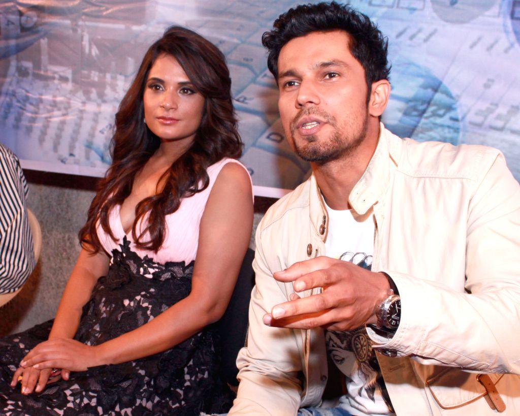 Actors Randeep Hooda and Richa Chadda during a press conference to promote their upcoming film `Main Aur Charles` in Noida, on Oct 27, 2015. - Randeep Hooda and Richa Chadda