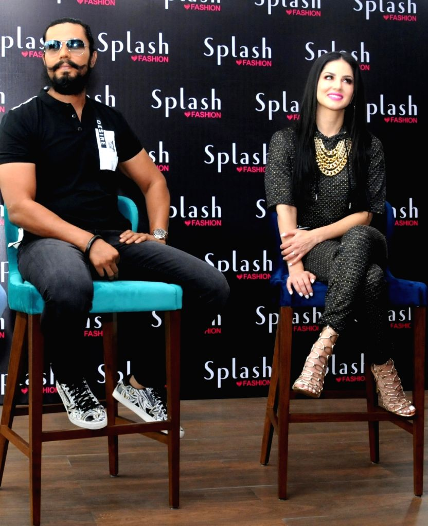 Actors Randeep Hooda and Sunny Leone during a programme in Amritsar on June 1, 2018. - Randeep Hooda and Sunny Leone