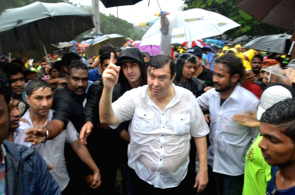 Actors Randhir Kapoor and Ranbir Kapoor participate in a procession for the immersion of R K Studios idol of Lord Ganesh on the final day of the Ganesh festival, in Mumbai, on Sept 15, 2016. - Randhir Kapoor and Ranbir Kapoor