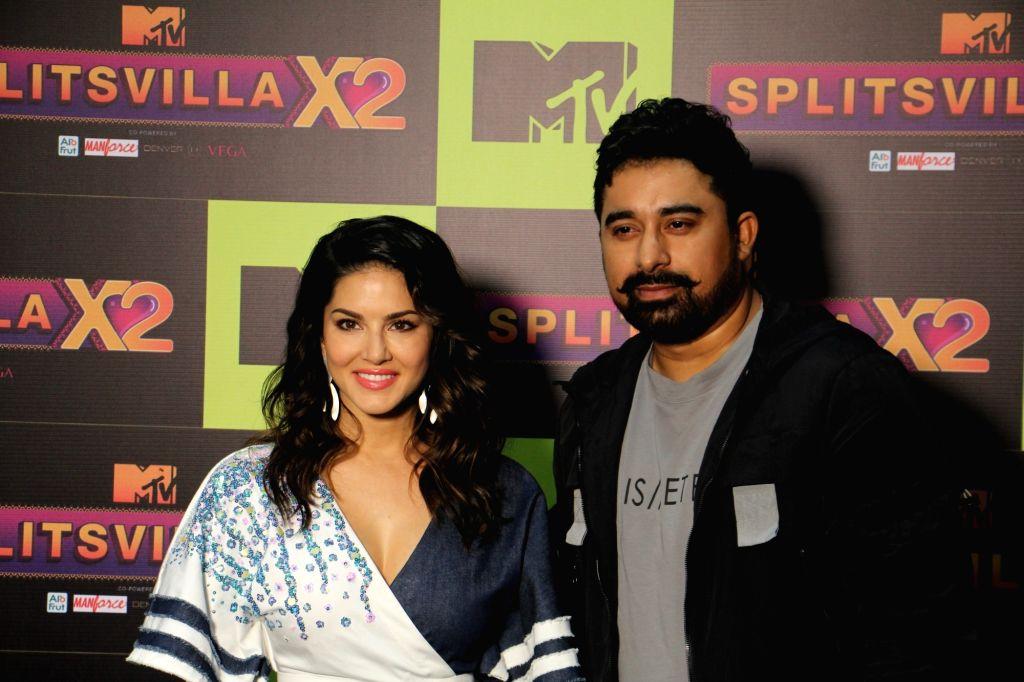 Actors Rannvijay Singh and Sunny Leone during a programme on MTV SplitsVilla in Mumbai, on July 17, 2019. - Rannvijay Singh and Sunny Leone