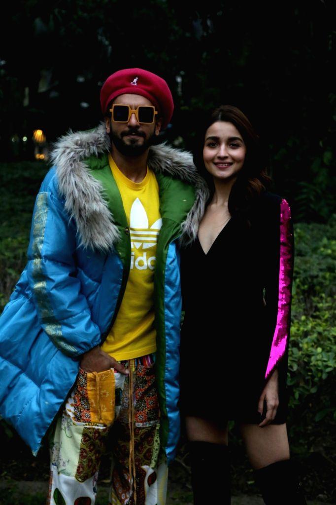 "Actors Ranveer Singh and Alia Bhatt during a photo shoot ahead of release of their upcoming film ""Gully Boy"" in New Delhi on Feb 12, 2019. - Ranveer Singh and Alia Bhatt"