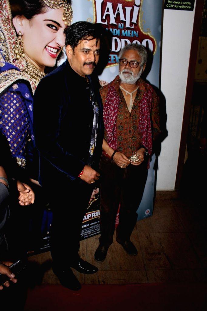 Actors Ravi Kishan and Sanjay Misra during the Sangeet Ceremony for film Laali Ki Shaadi Mein Laaddoo Deewana in Mumbai on March 21, 2017. - Ravi Kishan and Sanjay Misra