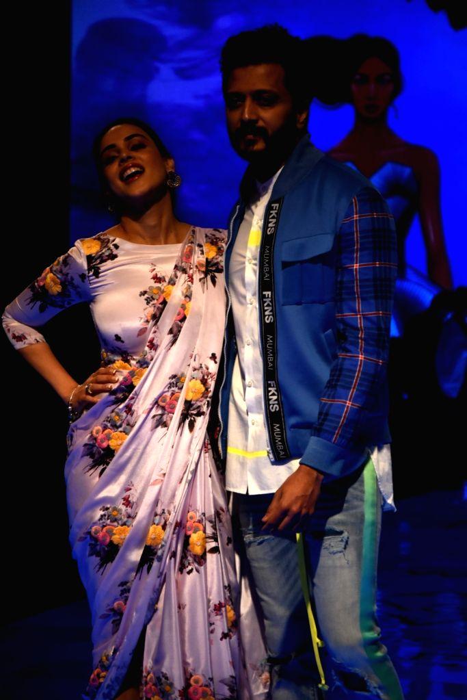 Actors Riteish Deshmukh and Genelia Deshmukh walk the ramp at the Lakme Fashion Week Winter/Festive 2019 in Mumbai on Aug 25, 2019. - Riteish Deshmukh and Genelia Deshmukh