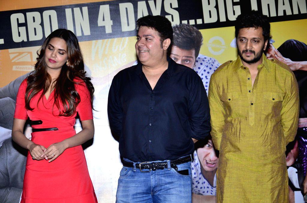 Actors Riteish Deshmukh, Esha Gupta, filmmaker Sajid Khan during the success party of film Humshakals organised by Fox Star Studios and filmmaker Vashu Bhagnani in Mumbai on June 24, 2014. - Riteish Deshmukh, Esha Gupta and Sajid Khan