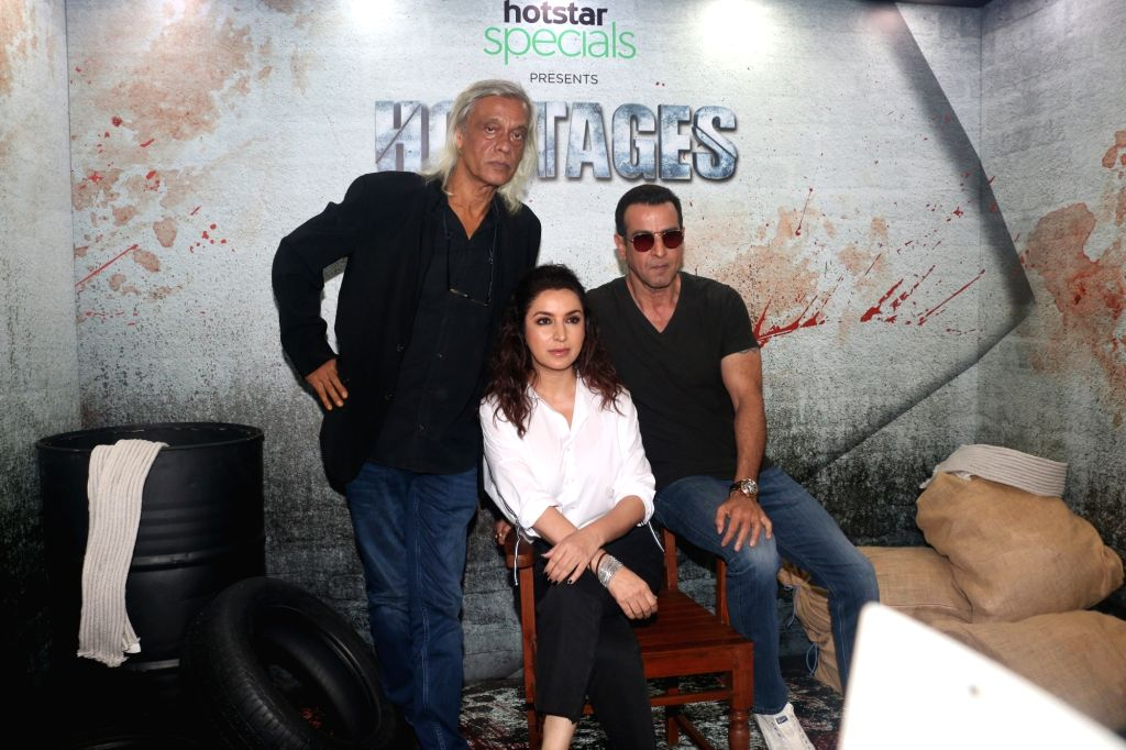 Actors Ronit Roy and Tisca Chopra with director Sudhir Mishra at the screening of their web series 'Hostages', in Mumbai, on May 22, 2019. - Sudhir Mishra, Ronit Roy and Tisca Chopra