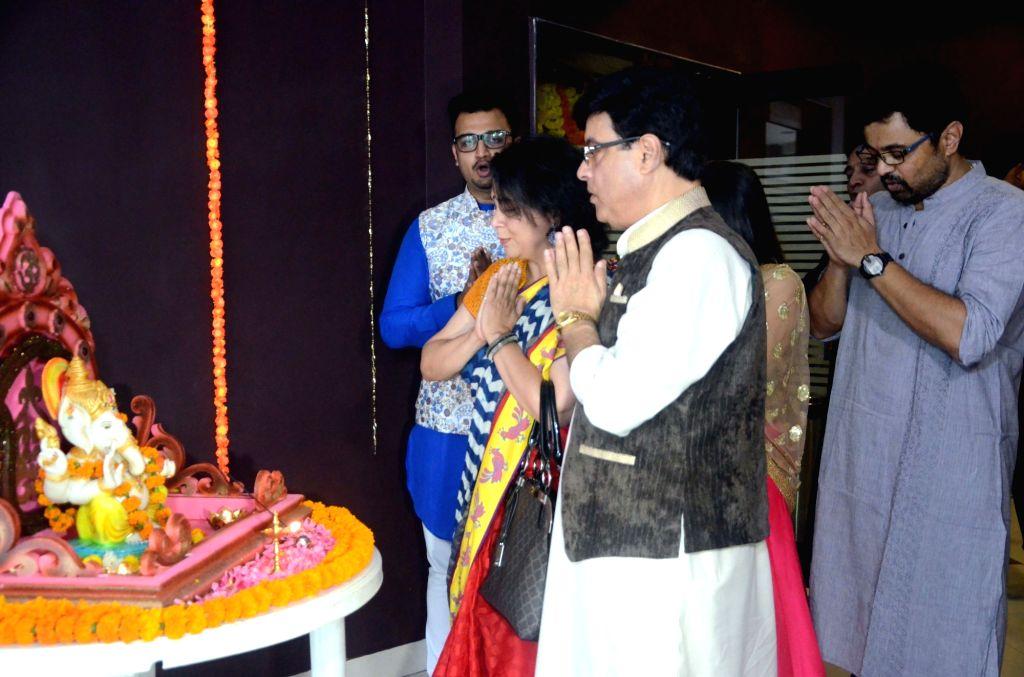 "Actors Sachin Pilgaonkar, Supriya Pilgaonkar and Swapnil Joshi pay obeisance to lord Ganesha at the trailer launch of the movie ""Tula Kalnar Nahi"" in Mumbai on Aug 21, 2017. - Sachin Pilgaonkar, Supriya Pilgaonkar and Swapnil Joshi"