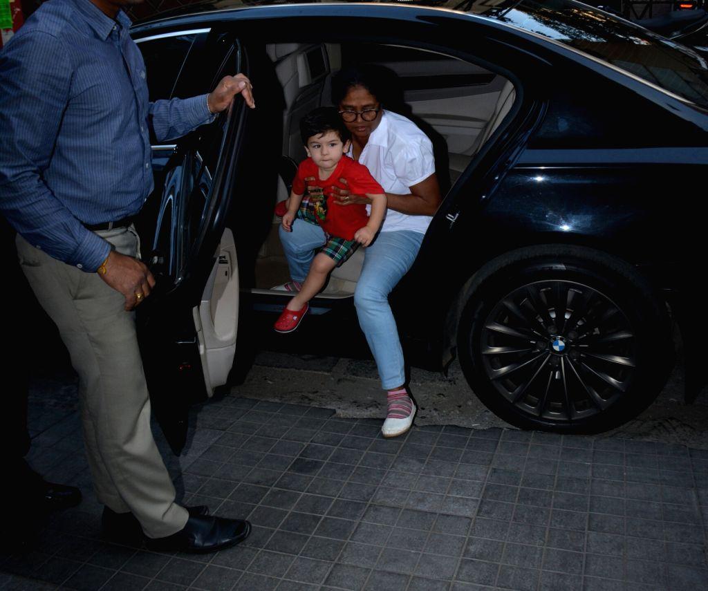 Actors Saif Ali Khan and Kareeena Kapoor's son Taimur Ali Khan seen at Soha Ali Khan's house in Bandra on Feb. 1, 2019. - Saif Ali Khan, Kareeena Kapoor, Taimur Ali Khan and Soha Ali Khan