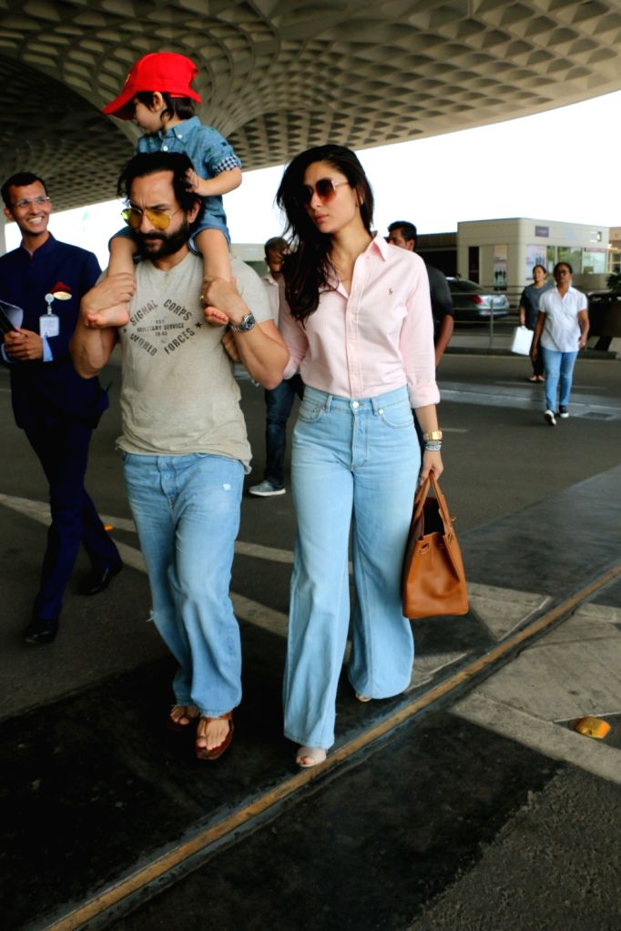 Actors Saif Ali Khan and Kareena Kapoor Khan with their son Taimur Ali Khan seen at Chhatrapati Shivaji International Airport, Mumbai, on April 10, 2019. - Saif Ali Khan, Kareena Kapoor Khan and Taimur Ali Khan