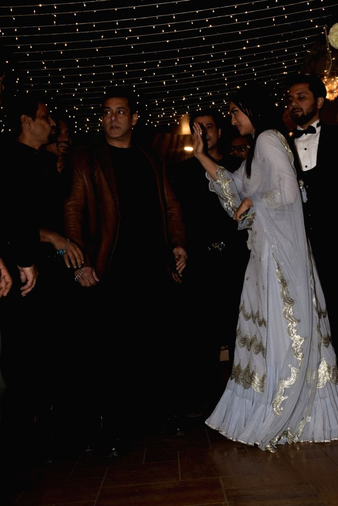 Actors Salman Khan and Sonakshi Sinha arrive at their friend's wedding reception in Mumbai, on Feb 16, 2019. - Salman Khan and Sonakshi Sinha