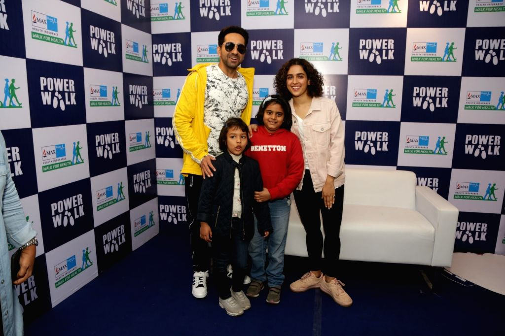 Actors Sanya Malhotra and Ayushmann Khurrana during Walk for Health in New Delhi on Feb 18, 2018. - Sanya Malhotra and Ayushmann Khurrana