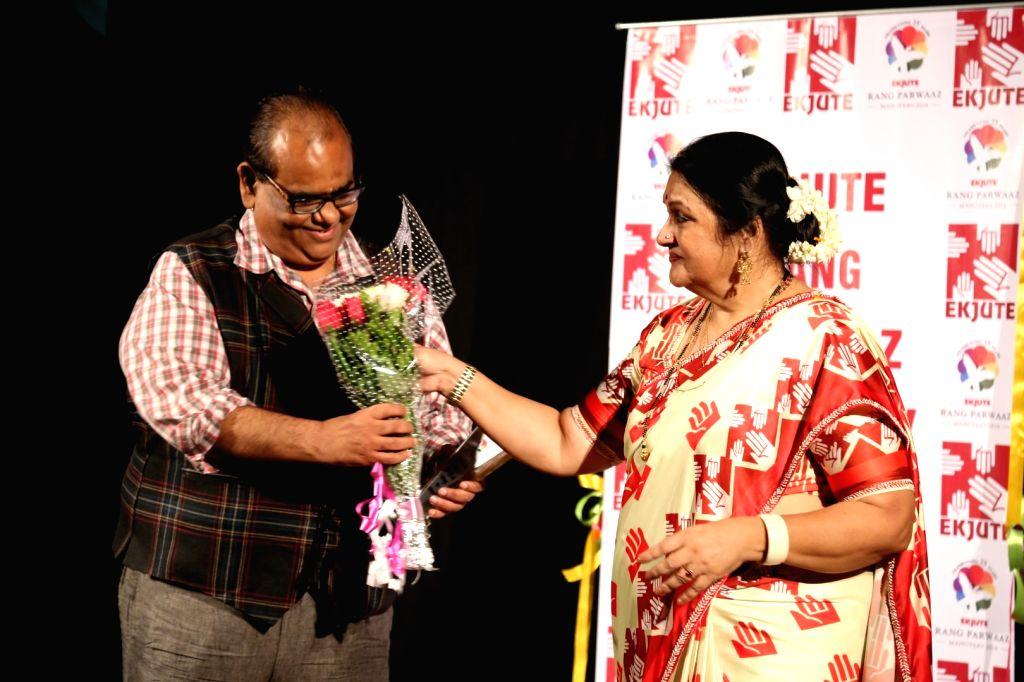 Actors Satish Kaushik and Nadira Babbar during the opening ceremony of Rang Parwaaz Mahotsav by Nadira Babbar to celebrate 35 years of Ekjute in Mumbai on Sept. 24, 2016. - Satish Kaushik and Nadira Babbar