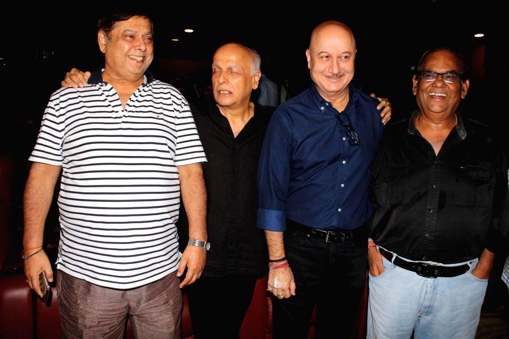 "Actors Satish Kaushik, Anupam Kher, directors Mahesh Bhatt and David Dhawan during the trailer launch of film ""Ranchi Diaries"" in Mumbai on Sept 12, 2017. - Satish Kaushik and Anupam Kher"