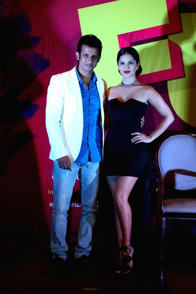 Actors Sharman Joshi and Sunny Leone during the release of song Tu Zaroorat Nahi Tu Zaroori Hai from film Fuddu in Mumbai on Sep 20, 2016. - Sharman Joshi and Sunny Leone