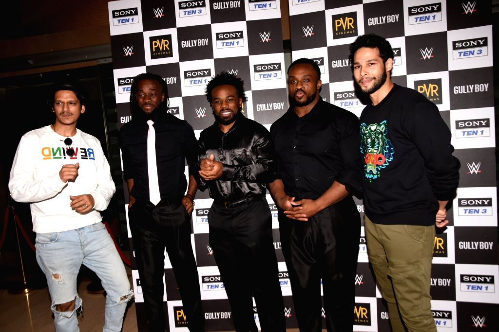 Actors Siddhant Chaturvedi and Vijay Verma with World Wrestling Entertainment (WWE) wrestlers Xavier Woods, Big E, Kofi Kingston, who are in India on a three-day tour, during a programme in ... - Siddhant Chaturvedi and Vijay Verma