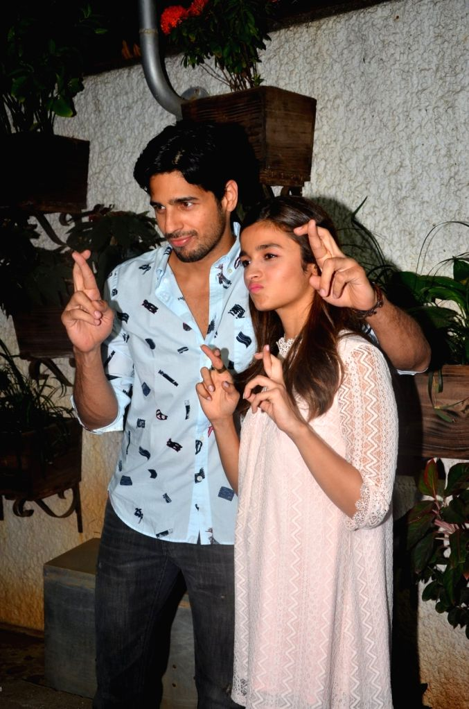 Actors Sidharth Malhotra and Alia Bhatt during the screening of film Kapoor and Sons in Mumbai, on March 17, 2016. - Sidharth Malhotra and Alia Bhatt