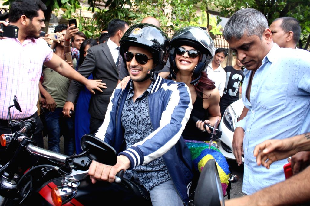 """Actors Sidharth Malhotra and Jacqueline Fernandez special bike ride to promote his upcoming film """"A Gentleman"""" in Mumbai on Aug 17, 2017. - Sidharth Malhotra and Jacqueline Fernandez"""