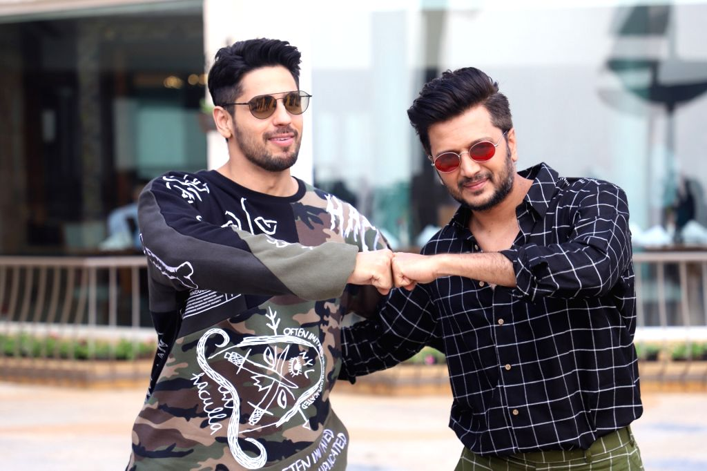 """Actors Sidharth Malhotra and Riteish Deshmukh during a programme organised to promote """"Marjaavaan"""" in Mumbai on Nov 13, 2019. - Sidharth Malhotra and Riteish Deshmukh"""