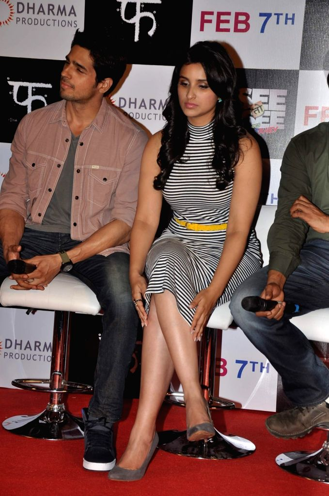 Actors Sidhrath Malhotra and Parineeti Chopra at the first look of their upcoming film Hasee Toh Phasee at PVR Cinemas in Mumbai on December 13, 2013. - Sidhrath Malhotra and Parineeti Chopra