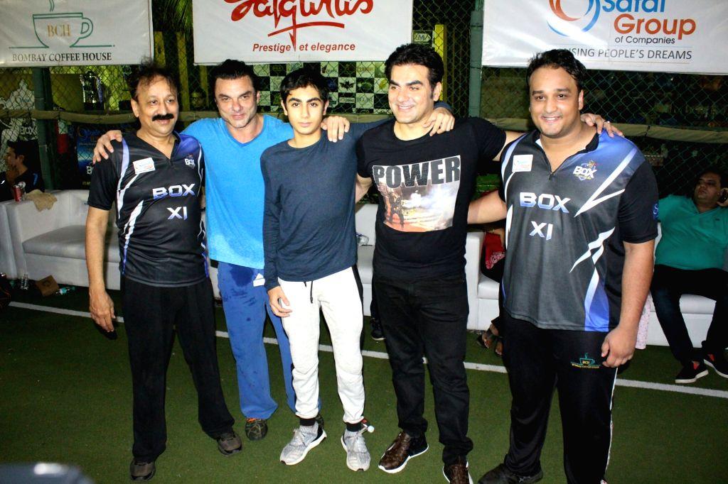 Actors Sohail Khan and Arbaaz Khan during a cricket match at St Andrews stadium in Mumbai on May 13, 2018. - Sohail Khan and Arbaaz Khan