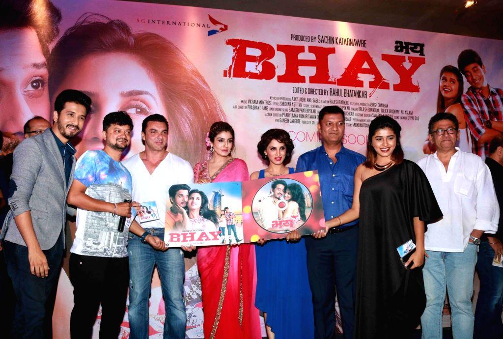 "Actors Sohail Khan, Raveena Tandon, Smita Gondkar during the music launch of film ""Bhay"" in Mumbai on Oct 25, 2016. - Sohail Khan, Raveena Tandon and Smita Gondkar"
