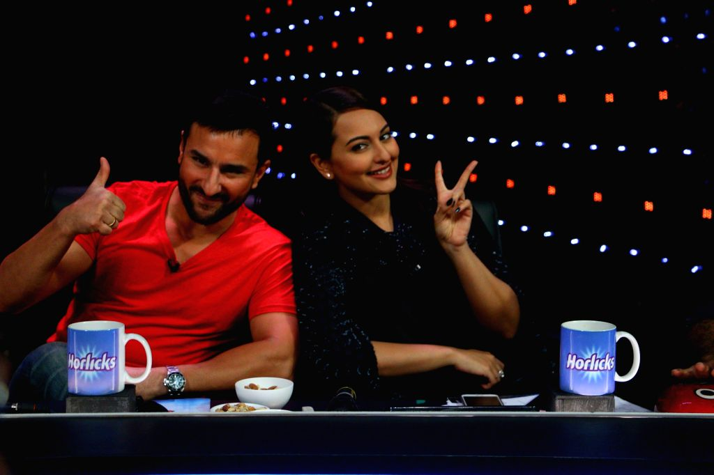 Actors Sonakshi Sinha and Saif Ali Khan during the promotion of film Phantom on the sets of Indian Idol Junior 2015, in Mumbai. - Sonakshi Sinha and Saif Ali Khan