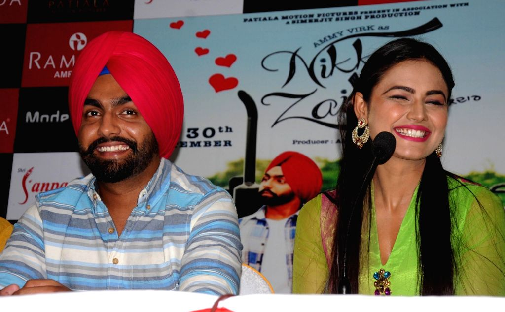 "Actors Sonia Kaur and Ammy Virk during a press conference to promote of their upcoming Punjabi film ""Nikka Zaildar"" in Amritsar on Sept 26, 2016. - Sonia Kaur and Ammy Virk"