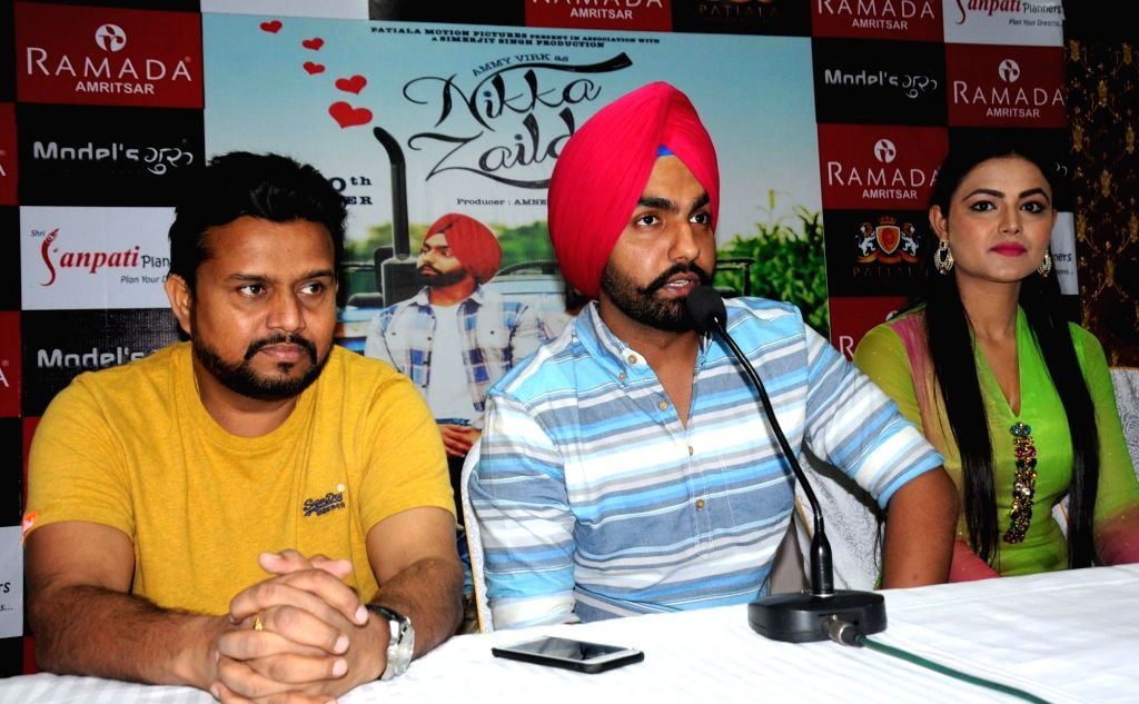 "Actors Sonia Kaur, Karamjit Anmol and Ammy Virk during a press conference to promote of their upcoming Punjabi film ""Nikka Zaildar"" in Amritsar on Sept 26, 2016. - Sonia Kaur, Karamjit Anmol and Ammy Virk"