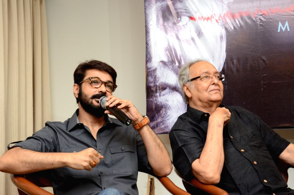 Actors Soumitra Chatterjee and Prosenjit Chatterjee during a programme in Kolkata on April 19, 2017. - Soumitra Chatterjee and Prosenjit Chatterjee