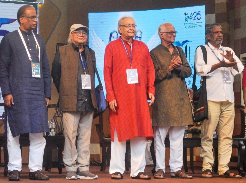Actors Soumitra Chatterjee, Manoj Mitra, Rudra Prasad and other dignitaries during 25th Kolkata International Film Festival (KIFF) in Kolkata on Nov 12, 2019. - Soumitra Chatterjee, Manoj Mitra and Rudra Prasad