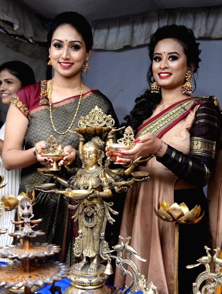 "Actors Spoorthi and Savitha Devaraj Reddy at the inauguration of ""Bangalore Utsav Diwali Shopping Carnival"", in Bengaluru on Oct 11, 2019. - Spoorthi and Savitha Devaraj Reddy"