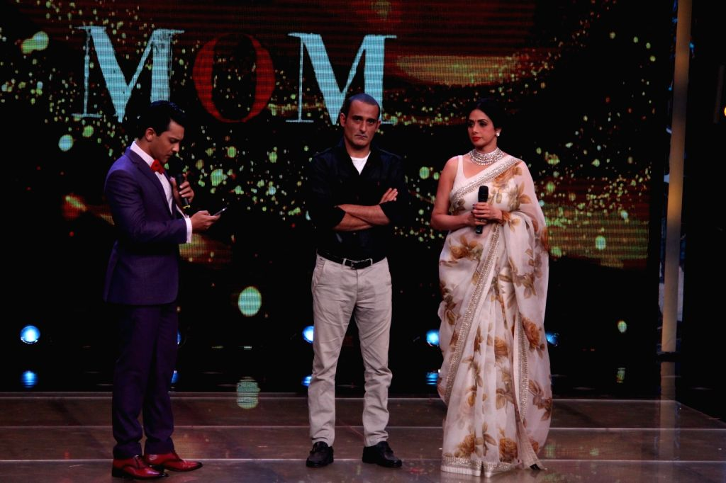 "Actors Sridevi Boney Kapoor and Akshaye Khanna on the sets of ""Sa Re Ga Ma Pa Li'l Champs Season 6"" to promote their upcoming film ""Mom"" in Mumbai, on July 7, 2017. - Sridevi Boney Kapoor and Akshaye Khanna"