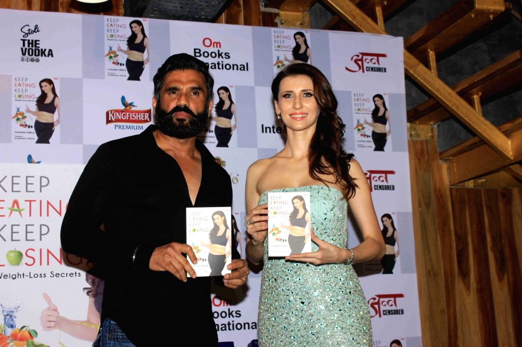 Actors Sunil Shetty and Claudia Ciesla during the launch of her book on nutrition 'Keep Eating Keep Losing' in Mumbai on June 1, 2016. - Sunil Shetty and Claudia Ciesla