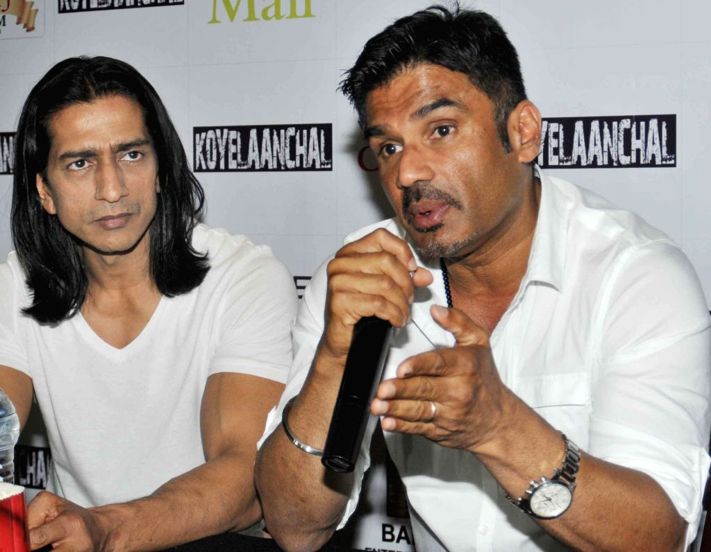 Actors Sunil Shetty and Vipinno during a press conference to promote their upcoming film 'Koyelaanchal' in Noida on May 4, 2014. - Sunil Shetty and Vipinno