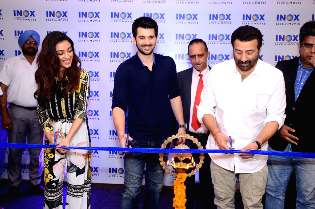 Actors Sunny Deol, Karan Deol and Sahher Bambba at the launch of a cinema hall in Jalandhar on Sep 14, 2019. - Sunny Deol, Karan Deol and Sahher Bambba