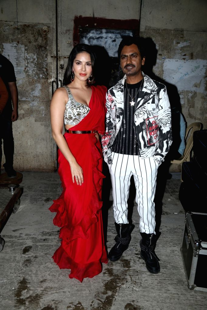 "Actors Sunny Leone and Nawazuddin Siddiqui during the shooting of a song for the upcoming film ""Motichoor Chaknachoor"" in Mumbai, on Sep 27, 2019. - Sunny Leone and Nawazuddin Siddiqui"