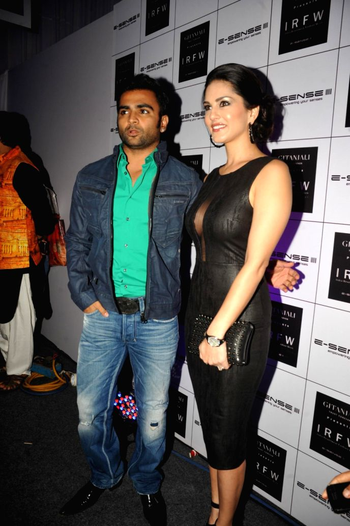 Actors Sunny Leone and Sachiin Josh during a  promotional event of their upcoming film `Jackpot` in Bangalore on Dec.13, 2013.
