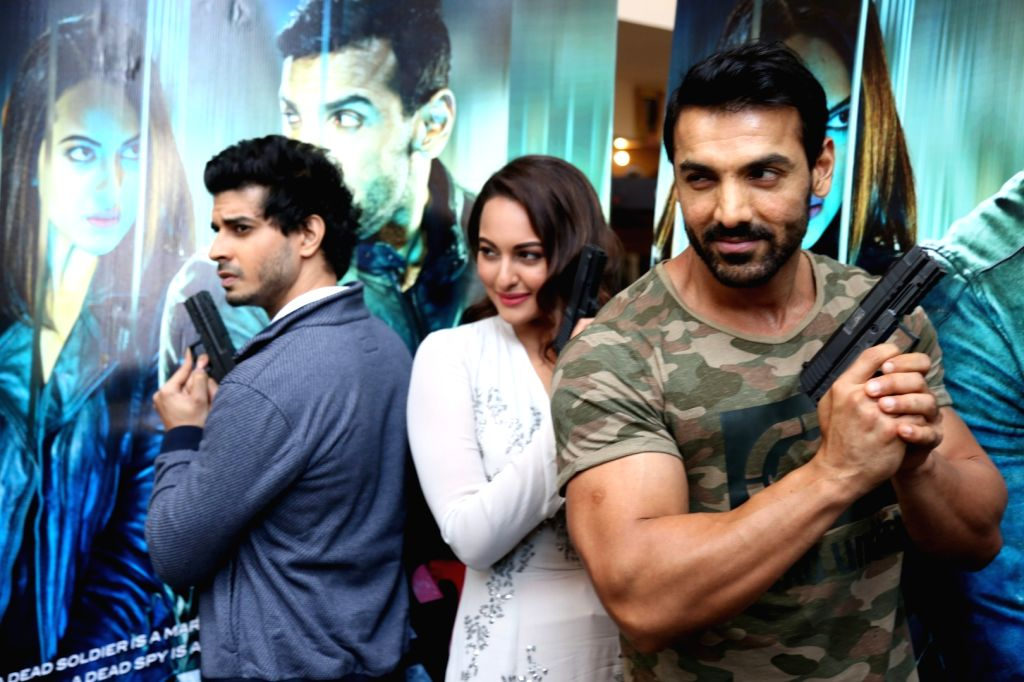 Actors Tahir Raj Bhasin, John Abraham and Sonakshi Sinha during the trailer launch of film Force 2, in Mumbai, on Sept 29, 2016. - Tahir Raj Bhasin, John Abraham and Sonakshi Sinha
