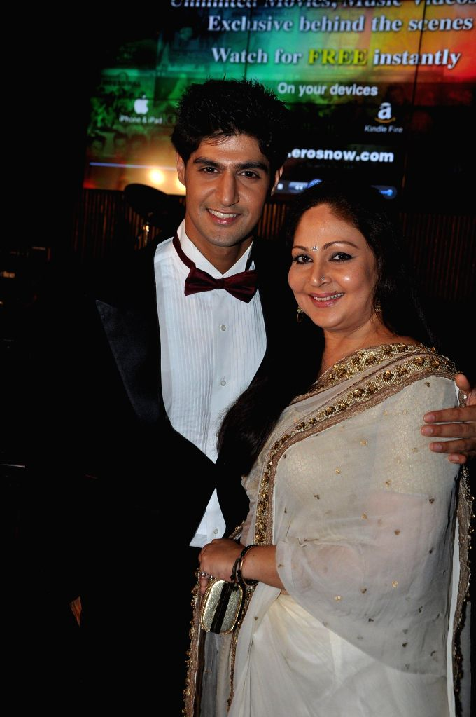Actors Tanuj Virwani with his mother Rati Agnihotri during the music launch of the movie Purani Jeans in Mumbai on April 16, 2014. - Tanuj Virwani