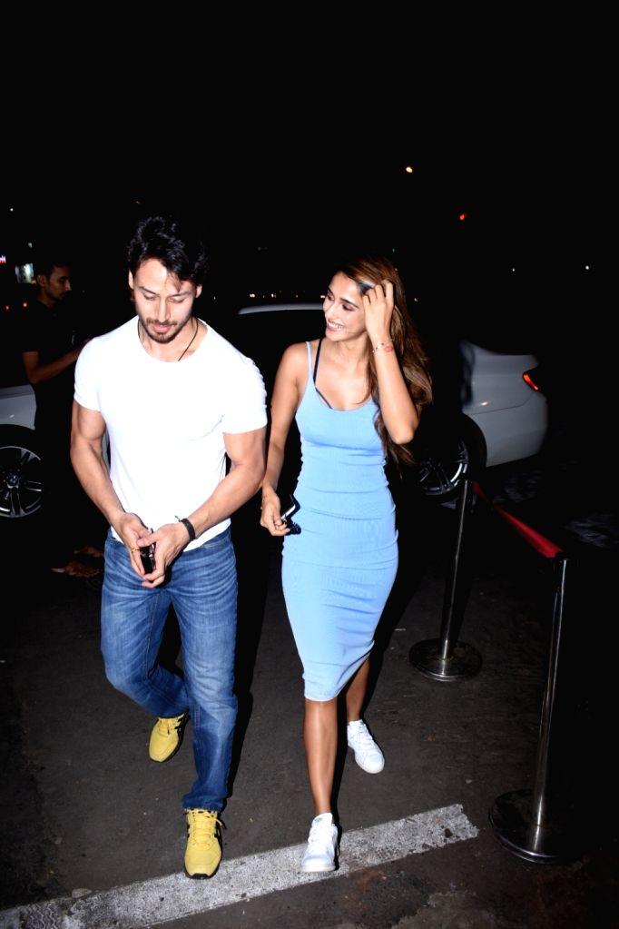 Actors Tiger Shroff and Disha Patani seen at Bandra in Mumbai, on July 18, 2019. - Tiger Shroff and Disha Patani