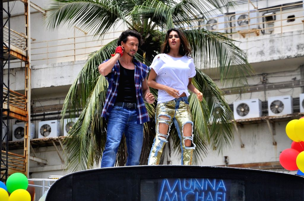 """Actors Tiger Shroff and Nidhhi Agerwal during the song launch of their upcoming film """"Munna Michael"""" in Mumbai, on June 18, 2017. - Tiger Shroff and Nidhhi Agerwal"""