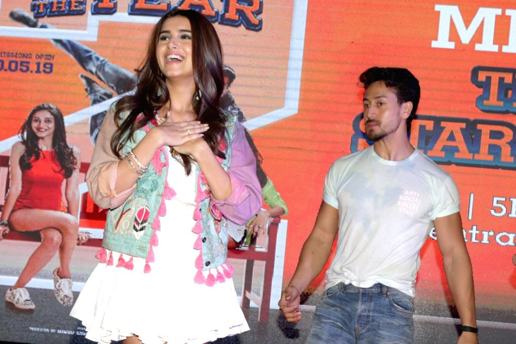"Actors Tiger Shroff and Tara Sutaria during a programme organised to promote their upcoming film ""Student of the Year 2"" in Uttar Pradesh's Noida, on May 5, 2019. - Tiger Shroff and Tara Sutaria"