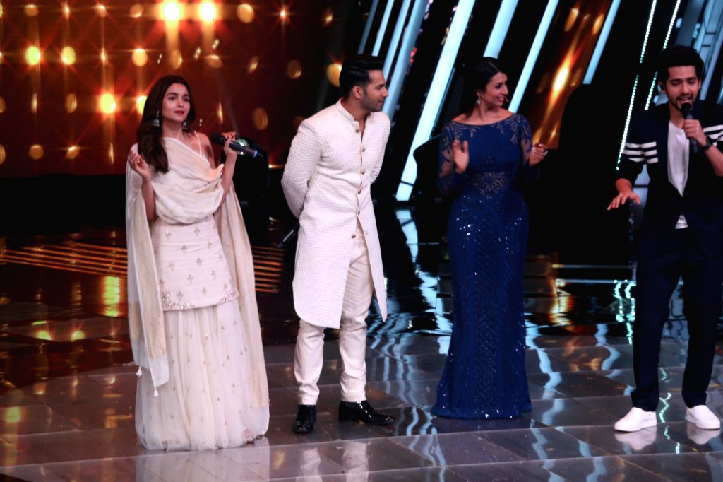 "Actors Varun Dhawan and Alia Bhatt during the promotion of film Kalank on the sets of ""The Voice"" in Mumbai on April 9, 2019. - Varun Dhawan and Alia Bhatt"