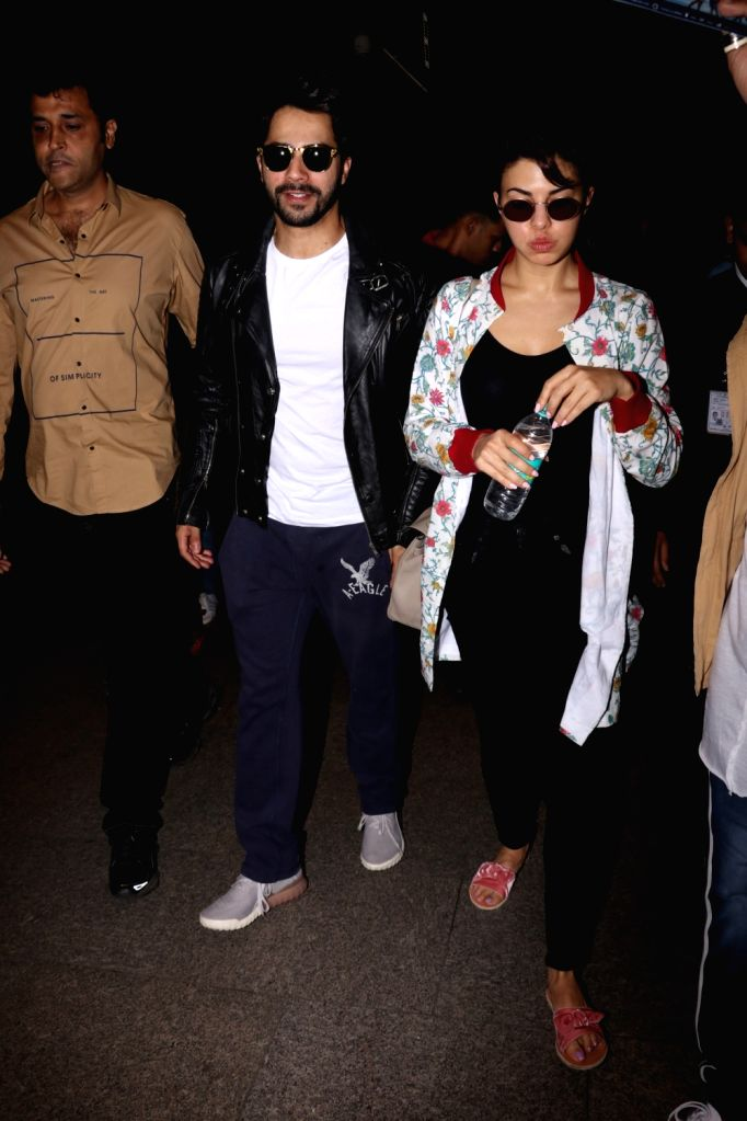 Actors Varun Dhawan and Jacqueline Fernandez spotted at Chhatrapati Shivaji Maharaj International airport in Mumbai on Sept 19, 2017. - Varun Dhawan and Jacqueline Fernandez