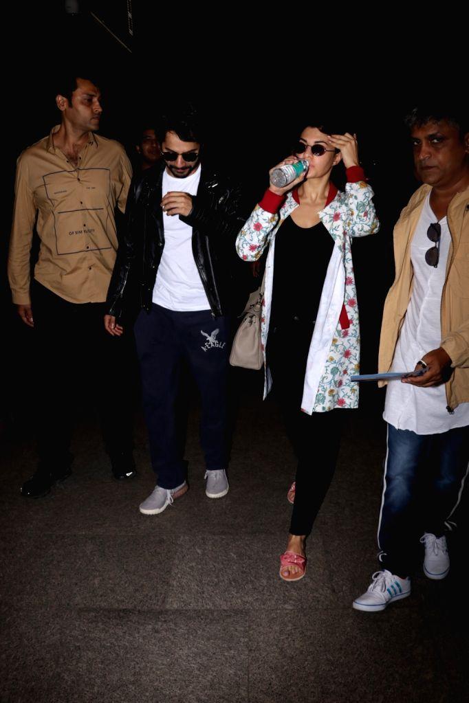 Actors Varun Dhawan and Jacqueline Fernandez spotted at Chhatrapati Shivaji Maharaj International airport in Mumbai on Sept 19, 2017. - Varun Dhawan and Jacqueline Fernandez