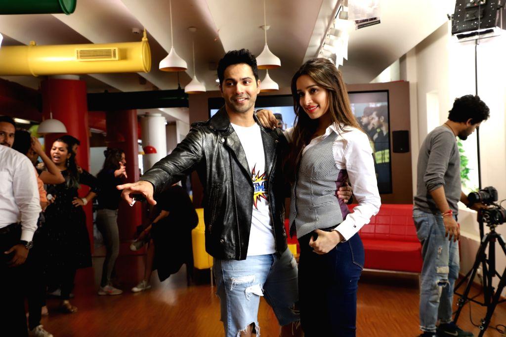 "Actors Varun Dhawan and Shraddha Kapoor during the promotions of their upcoming film ""Street Dancer 3D"", at Radio Mirchi studio in Mumbai on Jan 13, 2020. (Photo: IANS) - Varun Dhawan and Shraddha Kapoor"