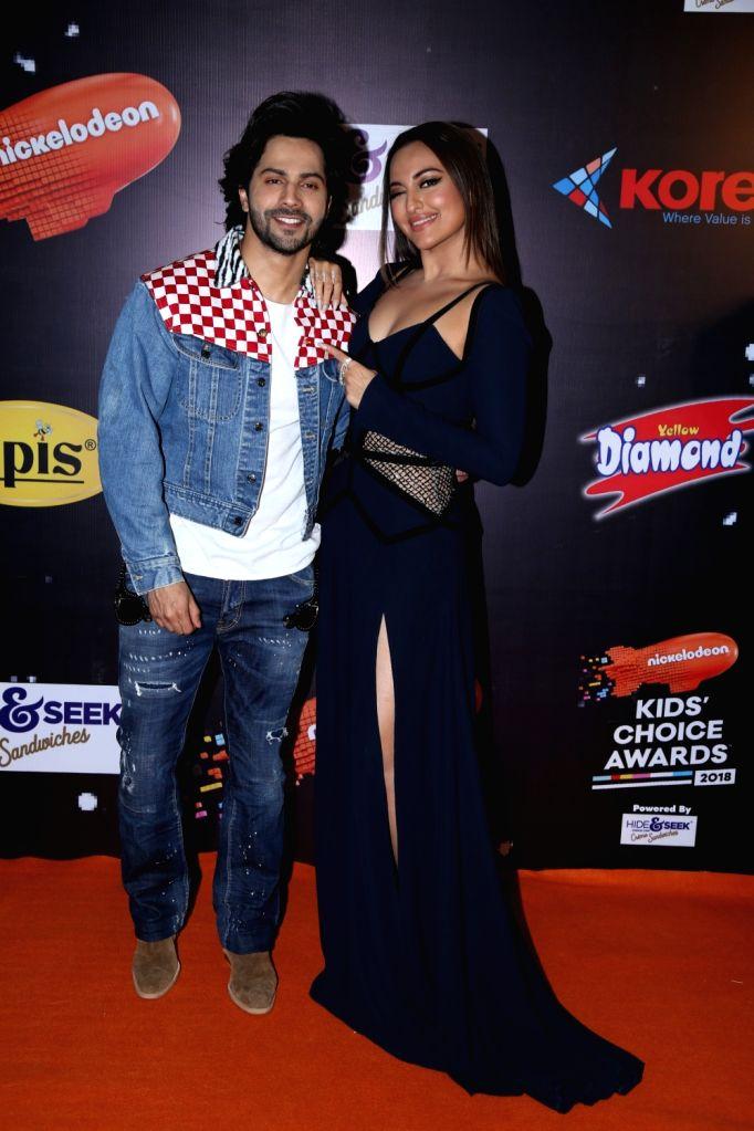 "Actors Varun Dhawan and Sonakshi Sinha at the orange carpet of ""Nickelodeon Kids Choice Awards 2018"" on Dec 14, 2018. - Varun Dhawan and Sonakshi Sinha"